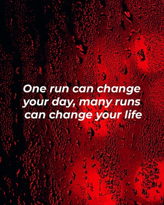 One run can change your day, many runs can change your life quote from Instagram on a red car window at night with raindrops.