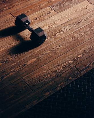 An Instagram post image of a small black weight sitting on a wooden floor.