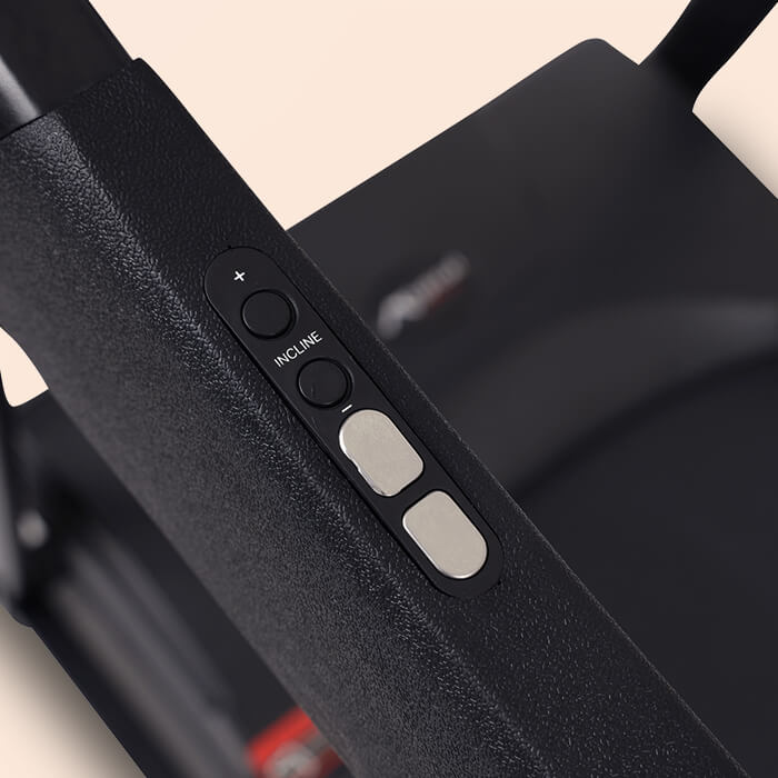 Close up photo of the AF-200 handle bar controls showing 2 black buttons for incline and 2 silver buttons for speed